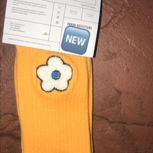 Cute orange socks with little white flower